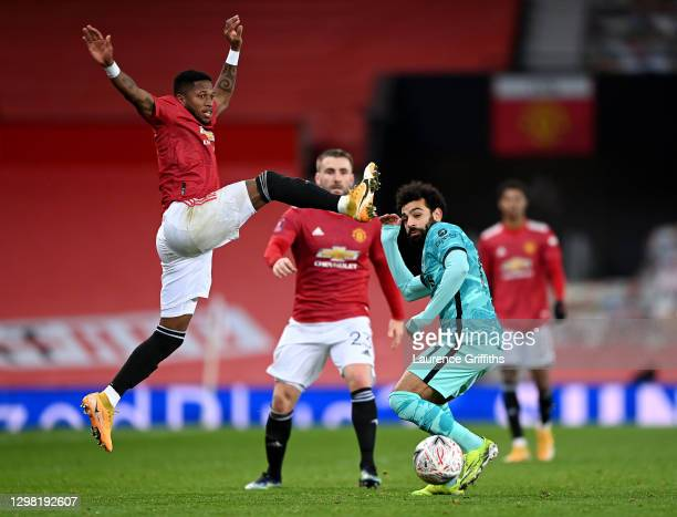 Fred of Manchester United jumps for the ball as Mohamed Salah of Liverpool takes evasive action during The Emirates FA Cup 4th Round match between...