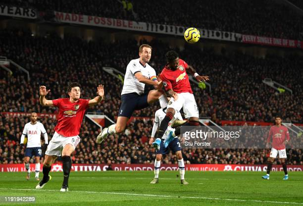 Fred of Manchester United jumps for the ball with Harry Kane of Tottenham Hotspur during the Premier League match between Manchester United and...