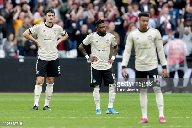 Fred of Manchester United looks dejected with Harry Maguire of Manchester United after West Ham's second goal during the Premier League match between...