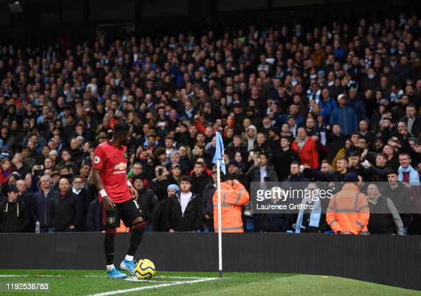 Fred of Manchester United looks to the crowd as missiles are thrown form the stands during the Premier League match between Manchester City and...