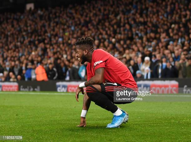 Fred of Manchester United reacts after being hit by a lighter thrown from the crowd during the Premier League match between Manchester City and...