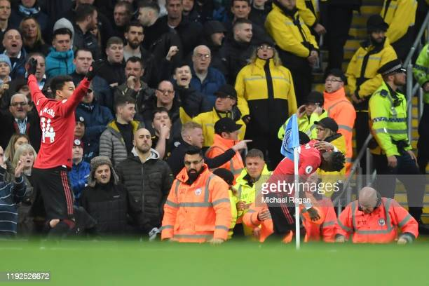 Fred of Manchester United reacts after being struck by an item thrown by the Manchester City fans during the Premier League match between Manchester...