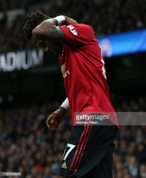 Fred of Manchester United reacts to being hit by objects thrown from the crowd during the Premier League match between Manchester City and Manchester...
