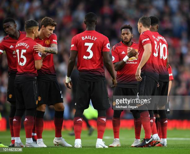 Fred of Manchester United shakes hands with his team mates prior to the Premier League match between Manchester United and Leicester City at Old...