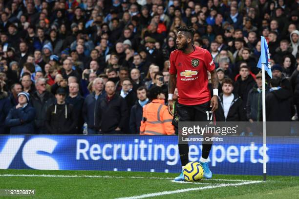 Fred of Manchester United takes a corner kick after being hit by objects thrown by the Manchester City fans during the Premier League match between...