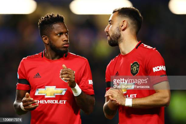 Fred of Manchester United talks with teammate Bruno Fernandes before the Premier League match between Chelsea FC and Manchester United at Stamford...
