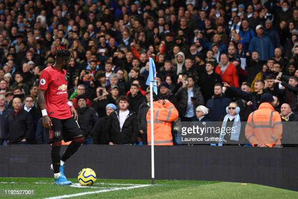 Fred of Manchester United walks to take a corner kick after being hit by objects thrown by the Manchester City fans during the Premier League match...