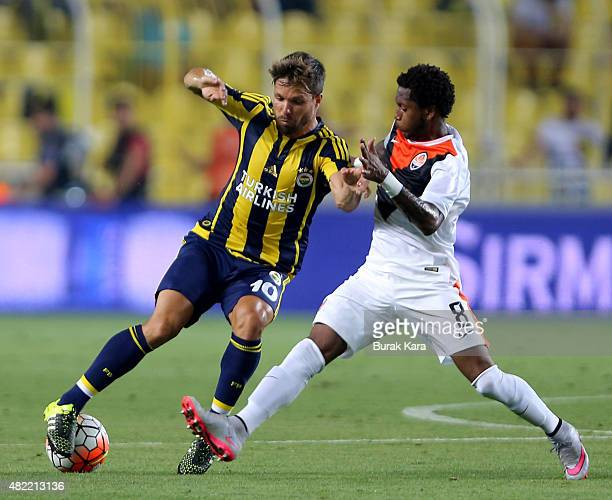Fred of Shaktar Donetsk rides the ball past Fenerbahce's Souza during UEFA Champions League Third Qualifying Round 1st Leg match betweeen Fenerbahce...