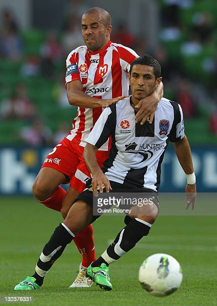 Fred of the Heart and Ali Abbas of the Jets contest for the ball during the round six ALeague match between the Melbourne Heart and the Newcastle...
