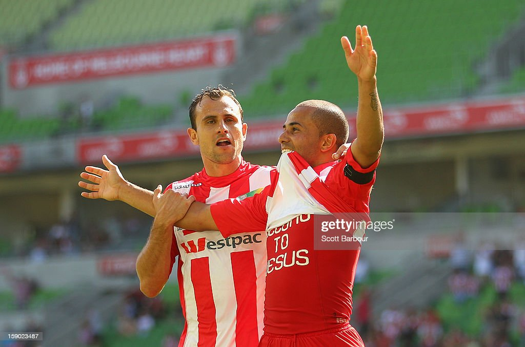 Fred of the Heart celebrates with Richard Garcia after scoring his teams third goal during the round 15 A-League match between the Melbourne Heart and the Brisbane Roar at AAMI Park on January 6, 2013 in Melbourne, Australia.