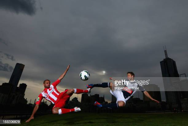 Fred of the Melbourne Heart and Adrian Leijer of the Melbourne Victory pose ahead of the 2012/13 ALeague season at Birrarung Marr on September 26...