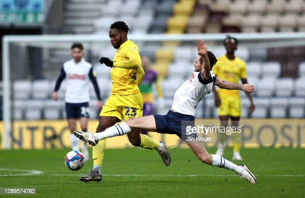 Fred Onyedinma of Wycombe Wanderers battles with Alan Browne of Preston North End during the Sky Bet Championship match between Preston North End and...