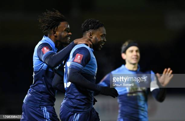 Fred Onyedinma of Wycombe Wanderers celebrates after scoring their sides first goal with team mate Admiral Muskwe during The Emirates FA Cup Fourth...