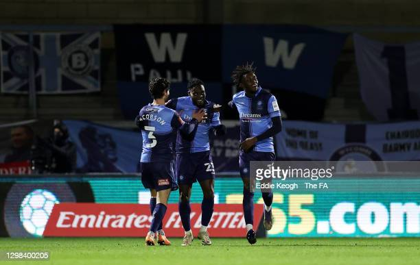 Fred Onyedinma of Wycombe Wanderers celebrates after scoring their sides first goal with team mates Joe Jacobson and Admiral Muskwe during The...