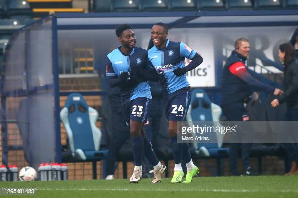 Fred Onyedinma of Wycombe Wanderers celebrates with Dennis Adeniran after scoring his team's first goal during the FA Cup Third Round match between...