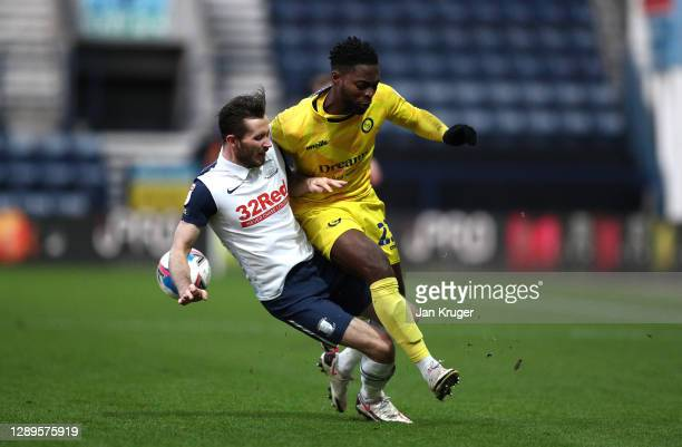 Fred Onyedinma of Wycombe Wanderers is tackled by Alan Browne of Preston North End during the Sky Bet Championship match between Preston North End...