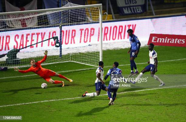 Fred Onyedinma of Wycombe Wanderers scores his sides first goal during The Emirates FA Cup Fourth Round match between Wycombe Wanderers and Tottenham...