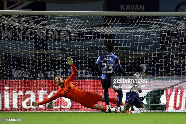 Fred Onyedinma of Wycombe Wanderers scores their sides first goal past Joe Hart of Tottenham Hotspur during The Emirates FA Cup Fourth Round match...