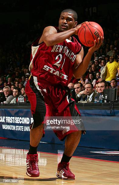 Fred Peete of the New Mexico State Aggies looks to make a pass play against the Texas Longhorns during the first round of the NCAA Men's Basketball...