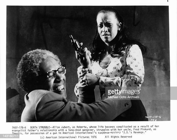 Fred Pinkhard and Alice Jubert struggle over gun in a scene from the film 'JD's Revenge' 1976