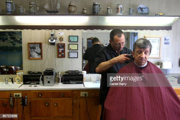 Fred Rene gets a haircut from Roger Kading March 30 2009 in downtown Fargo North Dakota Residents of Fargo and the surrounding area are awaiting the...
