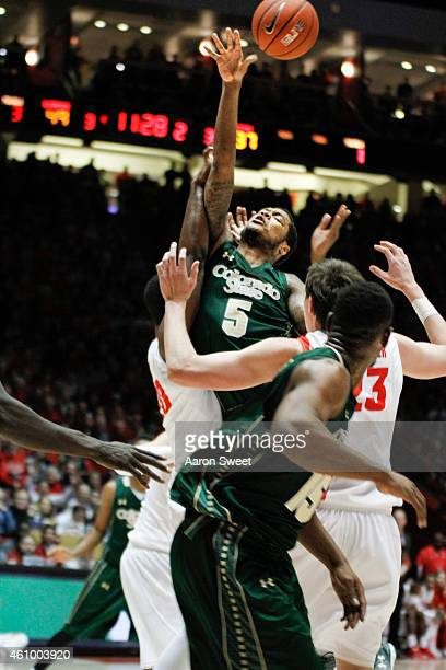 Fred Richardson III of the Colorado State Rams takes a shot between Sam Logwood and Joe Furstinger of the New Mexico Lobos during their game at The...