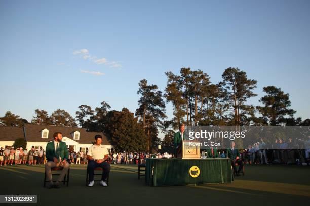 Fred Ridley, Chairman of Augusta National Golf Club, addresses the patrons during the Green Jacket Ceremony as Hideki Matsuyama of Japan and Dustin...