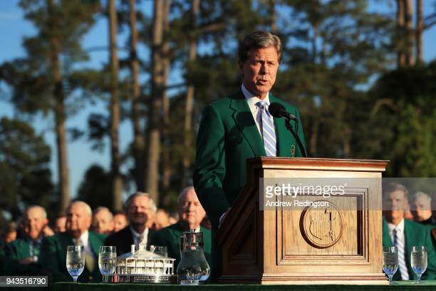 Fred Ridley Chairman of Augusta National Golf Club speaks during the green jacket ceremony as Patrick Reed of the United States looks on after...