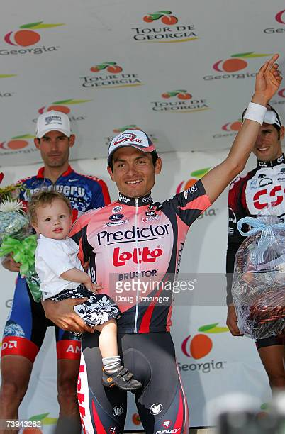 Fred Rodriguez of the US and riding for Predictor Lotto takes the podium with his son Aiden after he won Stage Six of the Tour de Georgia on April 21...