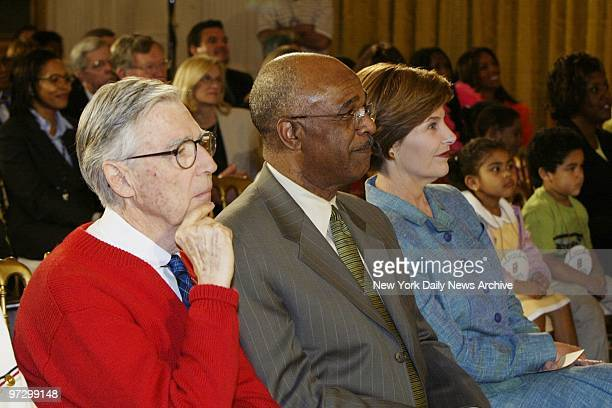 Fred Rogers formerly of TV's 'Mr Rogers Neighborhood' sits with Education Secretary Rod Paige and First Lady Laura Bush in the audience at an early...