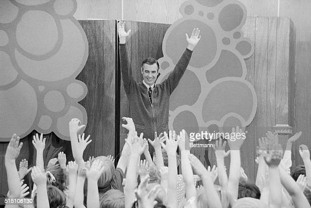 Fred Rogers of Mister Rogers' Neighborhood entertains children during a Mister Rogers' Day celebration Several thousand children from the surrounding...