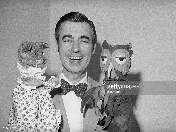 Fred Rogers of Mister Rogers' Neighborhood holds Henrietta Pussycat and 'X' the Owl during an interview Rogers is an ordained Presbyterian minister...