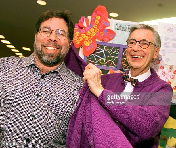 Fred Rogers Right Creator Of The Famed 'Mister Rogers' Neighborhood' Children's Television Show Presents His Trademark Sweater To Steve Wozniak...