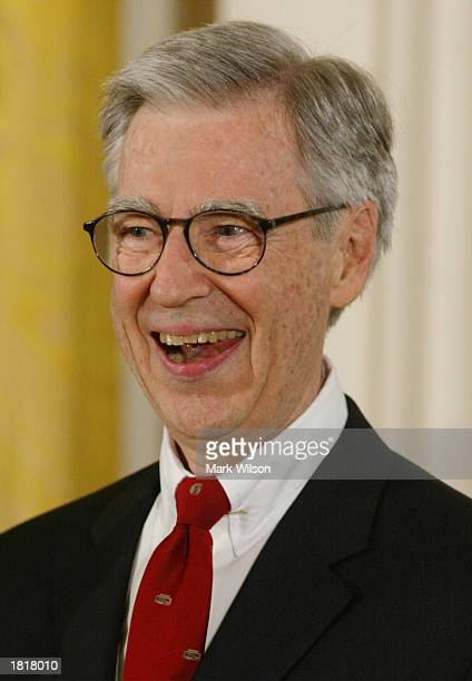 Fred Rogers smiles after receiving the Presidential Medal of Freedom Award from US President George W Bush during a ceremony at the White House July...