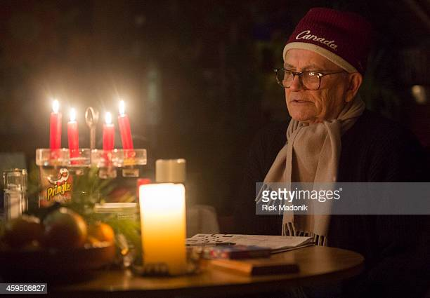 TORONTO DECEMBER 26 Fred Rohr and wife Erika Rohr are waiting out the power outage in their basement with a wood burning fireplace Fred Rohr had...