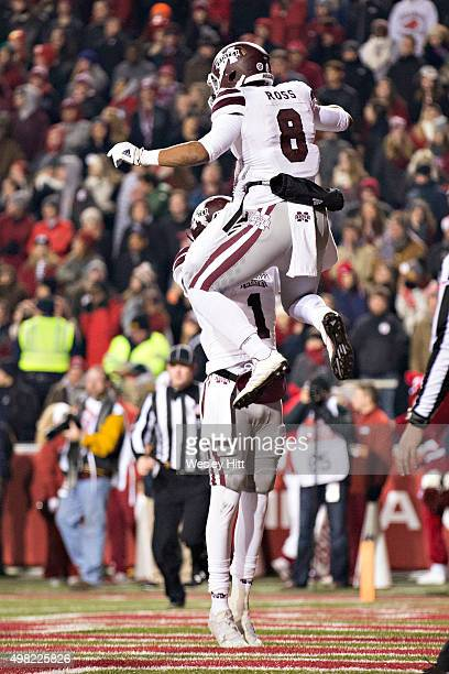 Fred Ross is lifted in the air by De'Runnya Wilson of the Mississippi State Bulldogs after scoring a touchdown against the Arkansas Razorbacks at...