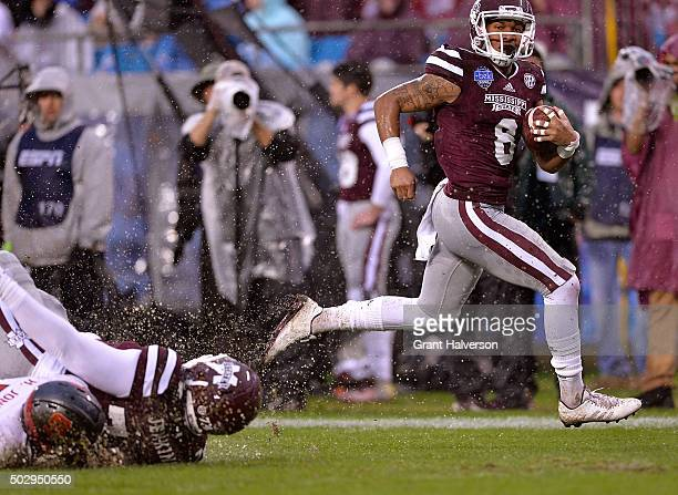 Fred Ross of the Mississippi State Bulldogs breaks away from the North Carolina State Wolfpack defense for a touchdown during the Belk Bowl at Bank...