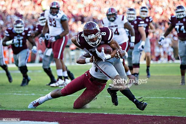 Fred Ross of the Mississippi State Bulldogs fights off a tackle and scores a touchdown during a game against the South Carolina Gamecocks at Davis...