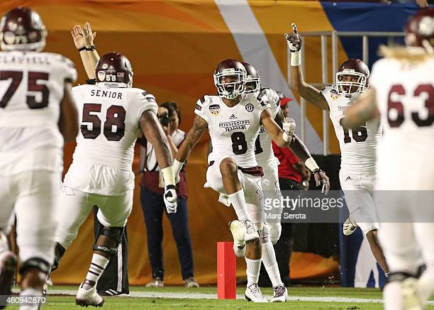 Fred Ross of the Mississippi State Bulldogs reacts after catching a ball in the end zone for a touchdown to end the first half of the Capital One...