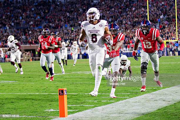 Fred Ross of the Mississippi State Bulldogs runs the ball for a touchdown during a game against the Mississippi Rebels at VaughtHemingway Stadium on...