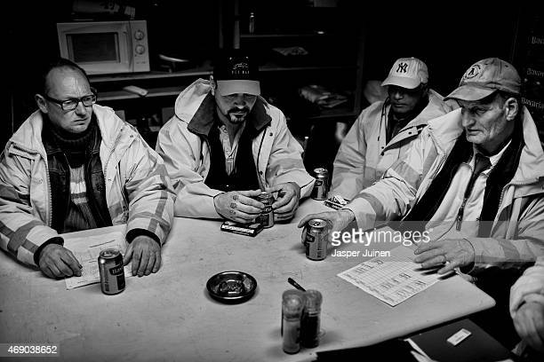 Fred Schiphorst sits ready to open a beer during a lunch time break with his mates Karel Slinger Marco van Vliet and Ramon Smits before heading off...