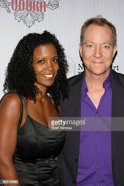 Fred Schneider and Guest arrive for the IMPERIA US Launch Party at the Statue of Liberty on September 7 2005 New York