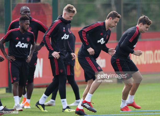 Fred Scott McTominay Nemanja Matic and Victor Lindelof of Manchester United in action during a first team training session at Aon Training Complex on...
