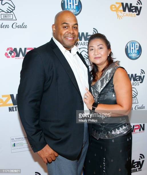 Fred Smith and guest attend the eZWay Awards Golden Gala at Center Club Orange County on August 30 2019 in Costa Mesa California