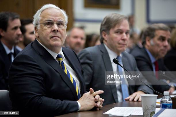 Fred Smith president and chief executive officer of FedEx Corp left looks towards a monitor during a House Transportation and Infrastructure...