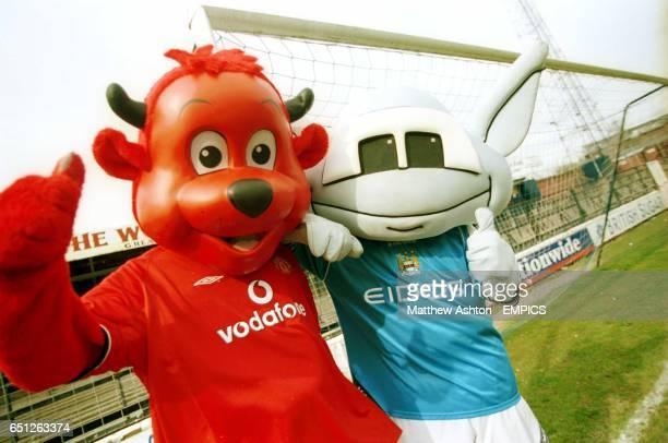 Fred the Red of Manchester United and Moonchester of Manchester City at the Battle of the Mascots match at Gay Meadow home of Shrewsbury Town