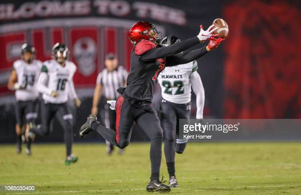Fred Trevillion of the San Diego State Aztecs catches the ball scoring a 69 yard touchdown scoring in the first half against the Hawaii Rainbow...