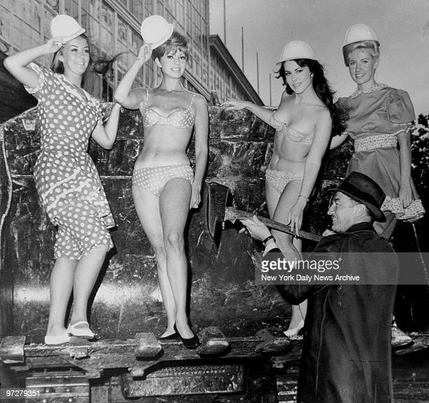 Fred Trump builder takes part in a bit of symbolism as he hands up ax at Coney Island just before the razing of Steeplechae Park begins Girls are...