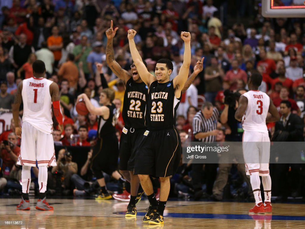 Fred Van Vleet #23 and Carl Hall #22 of the Wichita State Shockers celebrate after defeating the Ohio State Buckeyes 70-66 during the West Regional Final of the 2013 NCAA Men's Basketball Tournament at Staples Center on March 30, 2013 in Los Angeles, California.