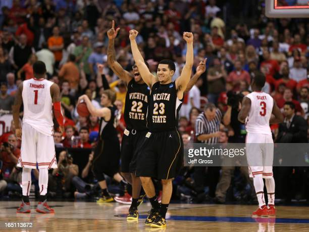 Fred Van Vleet and Carl Hall of the Wichita State Shockers celebrate after defeating the Ohio State Buckeyes 7066 during the West Regional Final of...
